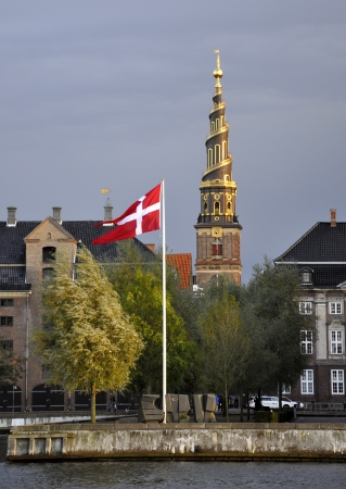 Danish Ministry of Foreign Affairs with the Danish flag in front and Our Savior Church in the background