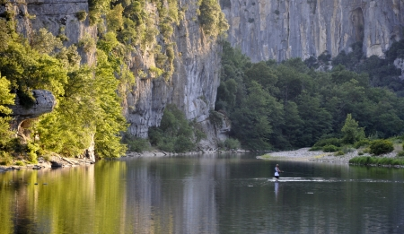 A man fishing in the river Shassezac  France  in the morning