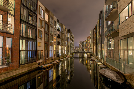 Sluseholmen is new residential area in Copenhagen harbor, inspired by houses in Amsterdam  Living with your boat close to the water  A night photo Editorial