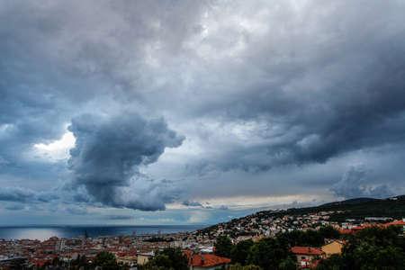 storm: Massive cloud to ground lightning bolts hitting the horizon of city lights