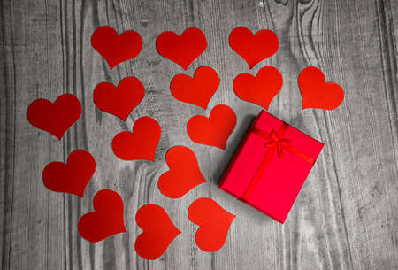 heart shaped stuff: Valentines day background with hearts and gift handmaded paper over old wood. Top view Stock Photo
