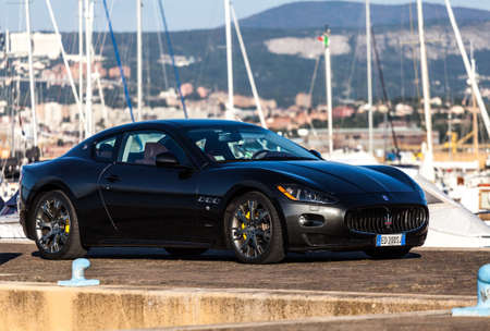 italian car: MUGGIA, ITALY MARCH 16, 2013: Photo of a Maserati GranTurismo S. The Maserati GranTurismo is a two-door, four-seat coup� � produced by the Italian car manufacturer Maserati.