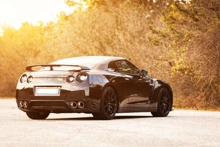 SISTIANA, ITALY JUNE 12, 2013: Photo of a Nissan GT-R Black Edition. The Nissan GT-R is a 2-door 2+2 sports car produced by Nissan and unveiled in 2007.