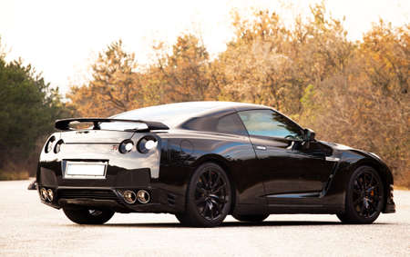 nissan: SISTIANA, ITALY JUNE 12, 2013: Photo of a Nissan GT-R Black Edition. The Nissan GT-R is a 2-door 2+2 sports car produced by Nissan and unveiled in 2007.