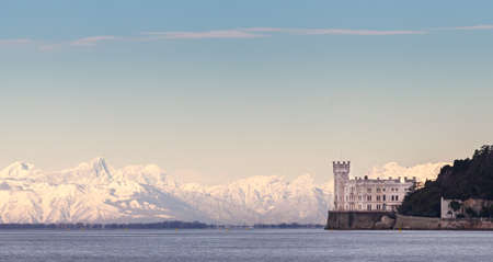 Miramar Castle with Italian Alps in background. Trieste ITALY 에디토리얼