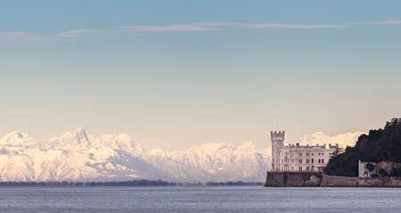 Miramar Castle with Italian Alps in background. Trieste ITALY Redakční