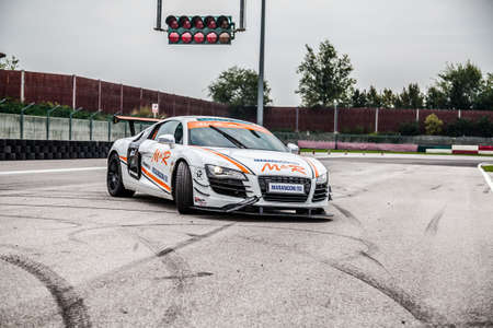 UDINE, Italy - OCTOBER 10, 2012: Audi R8 Safety car M&R Team ,  exhibition in drift and fast lap  in Autodromo Internazionale di Precenicco Lignano UDINE.