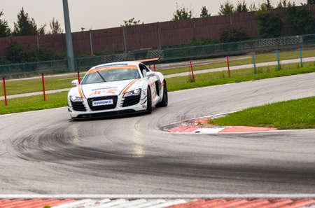 speed car: UDINE, Italy - OCTOBER 10, 2012: Audi R8 Safety car M&R Team ,  exhibition in drift and fast lap  in Autodromo Internazionale di Precenicco Lignano UDINE.