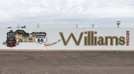 williams: WILLIAMS, AZ - JUNE 10: Picture of an Trains post and murales , in Arizona, taken June 10 2015 Williams was the last town to have its section of Route 66 bypassed, due to lawsuits that kept the last section of Interstate 40 in Arizona from being built aro Editorial
