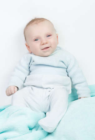 romper: Happy child with blue eyes and turquoise romper Stock Photo