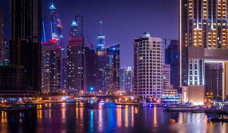 persian gulf: DUBAI, UAE - MAY 14: Futuristic buildings in Dubai Marina, Dubai, UAE. In the city of artificial channel length of 3 kilometers along the Persian Gulf, taken on 14 May 2014 in Dubai.