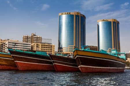 bur dubai: DUBAI, UAE-MAY17 2015: Dhows old wooden sailing vessels are docked along the Deira side of Dubai Creek