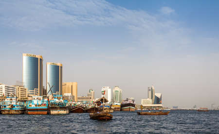 ferries: DUBAI, UAE-MAY17: Traditional Abra ferries  on May 17, 2015 in Dubai, UAE. Shipbuilding technology is unchanged from the 18th century.