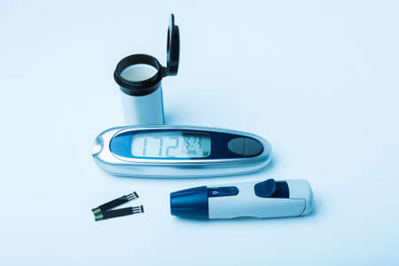 diabetes meter kit: Diabetic kit, Syringe pen with insulin and glucometer, Blood glucose test, Blood glucose meter kit. TONED IMAGE. Stock Photo