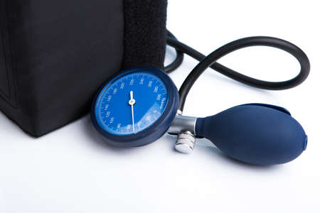 desease: Holding in hand sphygmomanometer isolated on white background Stock Photo