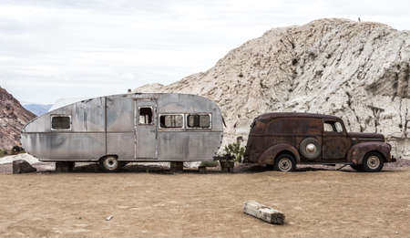oldie: NELSON , USA - JUNE 10 : Old rusty truck and old caravan in Nelson Nevada ghost town on June 10 ,2015