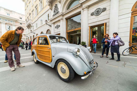 regularity: TRIESTE, ITALY - APRIL 3: Rare Fiat Topolino with wooden doors on APRIL 3, 2016. Trieste Opicina Historic regularity is run for Vintage and Classic Cars. Editorial