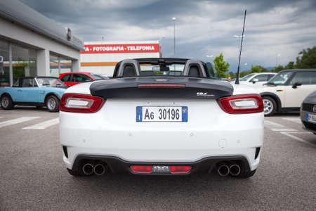 lb: Udine, July 13 2016: Abarth 124 Spider Prototype MultiAir 1.4 engine has 170 PS (125 kW; 168 hp) with top speed of 232 km  h (144 mph) and 0-100 km  h of 6.8 seconds, only weight 1,060 kg (2,337 lb)