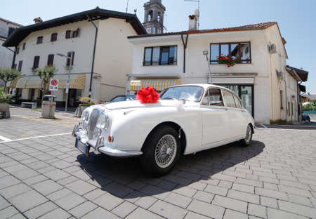 essentially: Udine,Italy 9 July 2016:The Daimler 2.5V8 was a 4 door produced in Coventry, England by Daimler.Launched late in 1962.It was essentially a rebadged Jaguar Mark 2 fitted with Daimlers 2.5tl V8 engine. Editorial