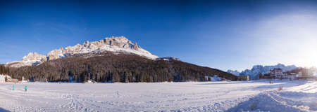 Lake Misurina in the Italian Dolomites in the winter  winter covered with snow. The hotel backed on to the mountains. Close photo of the hotel.