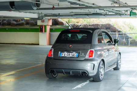 aggresive: Trieste,Italy June 18,2016:Photo of a Abarth 595 Competizione .The 595 differs substantially from that Tourism for the aggressive appearance and a few deliberately exaggerating the sporty character.