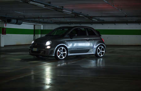 deliberately: Trieste,Italy June 18,2016:Photo of a Abarth 595 Competizione Cabrio.The 595 differs substantially from that Tourism for the aggressive appearance and a few deliberately exaggerating the sporty character.