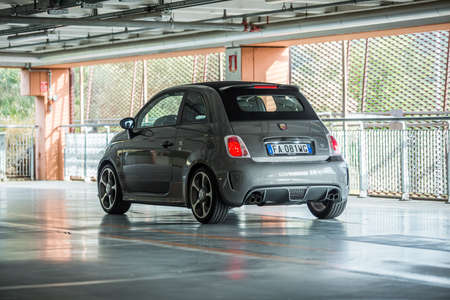 aggresive: Trieste,Italy June 18,2016:Photo of a Abarth 595 Competizione Cabrio.The 595 differs substantially from that Tourism for the aggressive appearance and a few deliberately exaggerating the sporty character.