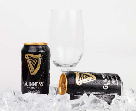 stout: Trieste, Italy July 08 2016,Guinness stout aluminum can on the white background. Irish dry stout originated in the brewery of Arthur Guinness, Dublin. One of the most successful beer brands worldwide. Editorial