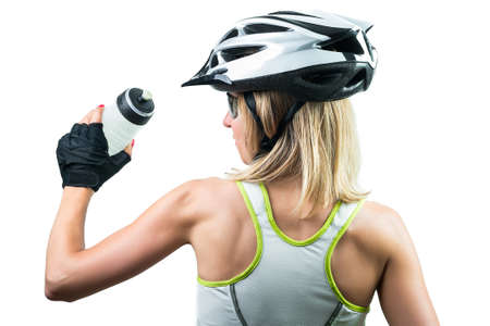 Cyclist drinking a energy sport drink from plastic bottle. Concept Winning in sports. Isolated on white background