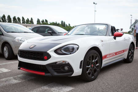 Udine, July 13 2016: Abarth 124 Spider Prototype MultiAir 1.4 engine has 170 PS (125 kW; 168 hp) with top speed of 232 km  h (144 mph) and 0-100 km  h of 6.8 seconds, only weight 1,060 kg (2,337 lb)