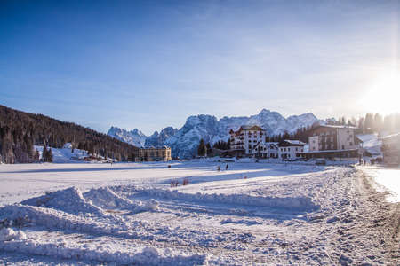 lake misurina: Lake Misurina in the Italian Dolomites in the winter  winter covered with snow. The hotel backed on to the mountains. Close photo of the hotel.