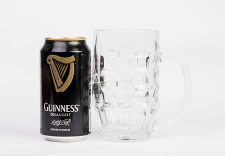 stout: Trieste, Italy July 08 2016: Four Guinness stout aluminum can on the white background. Irish dry stout originated in the brewery of Arthur Guinness, Dublin. One of the most successful beer brands worldwide.
