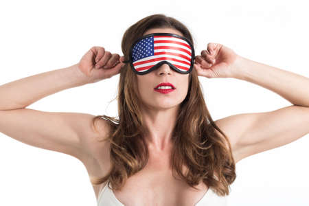 Young woman wearing eyemask. American Dream concept. Isolated on white background.