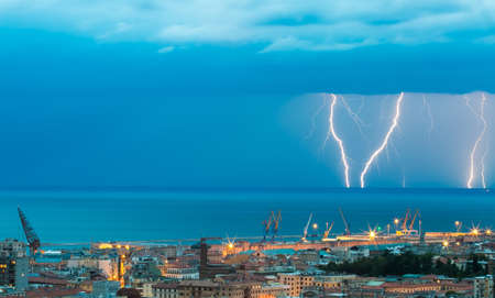 Thunder storm lightning strike on the sea  background at night. 스톡 콘텐츠 - 144008439