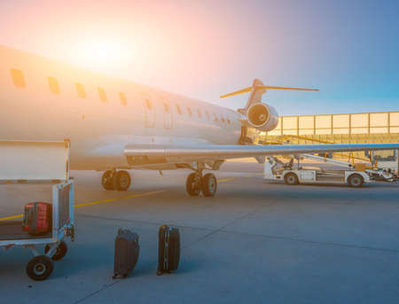 Airplane at the terminal gate ready for takeoff - Modern international airport during sunrise - Concept travel around the world 스톡 콘텐츠