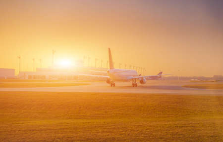 Airplane at the terminal gate ready for takeoff - Modern international airport during sunrise - Concept travel around the world 스톡 콘텐츠 - 144320463