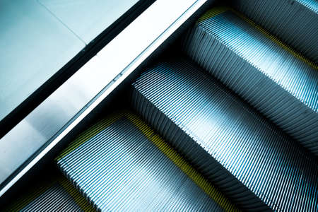 Abstract escalator in international airport with yellow bands and metal line steel 스톡 콘텐츠