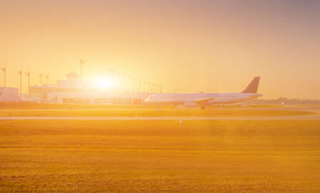 Airplane at the terminal gate ready for takeoff - Modern international airport during sunrise - Concept travel around the world 스톡 콘텐츠 - 144320559