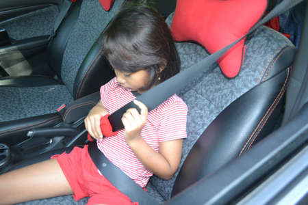 Little Girl Hold Seat Belt And Have Difficulty When Preparing Seat Belt Before Traveling