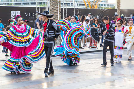 procession: participants of the parade in Downtown Dubai are procession in Mexican costumes