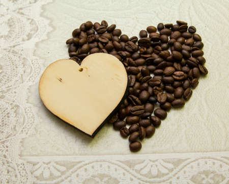 Acceptance and love - two hearts made of wood and made of coffee beans