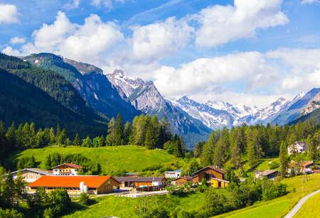 Alpine village under Innsbruck in Austria in the green valley among the mountains