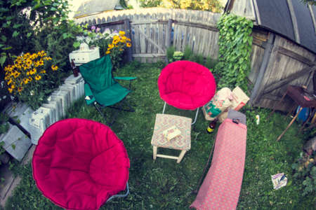 plot: relaxation area for guests on a green summer garden plot