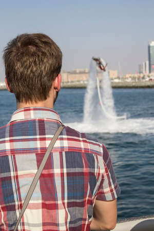 skydive: man watching the competitions on flaybording in Skydive Dubai