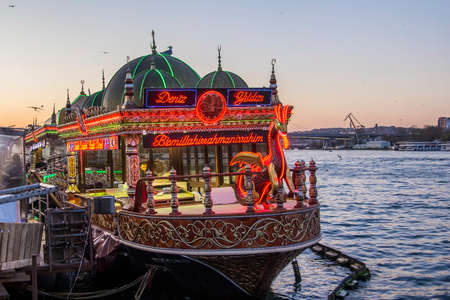 eminonu: floating cafe on the pier Eminonu in Istanbul