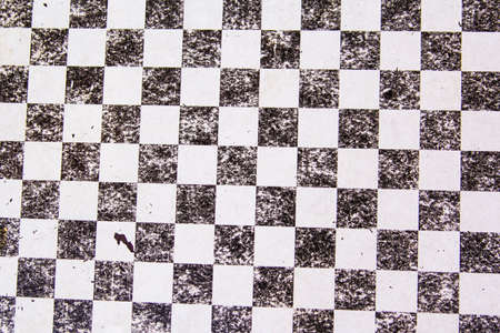 checkerboard: texture background of an old blackandwhite checkerboard