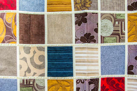 background texture of a patchwork of different pieces of fabric in the bazaar in Istanbul photo