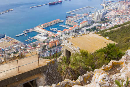 rock bottom: background landscape view of the ruined city at the bottom of the battery and to the Rock of Gibraltar
