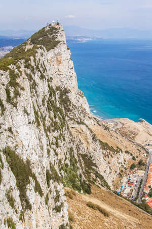 rare rocks: background landscape view of the Rock of Gibraltar, nature reserve and ocean Stock Photo