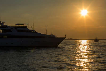 ocea: seascape view of a large motor yacht at sunset in Dubai